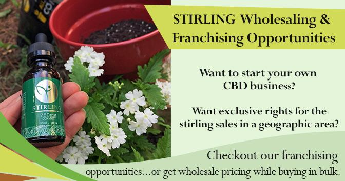 Stirling Franchising and Wholesaling Program. Person holding a CBD bottle
